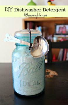 homemade dishwasher detergent in a vintage teal mason jar with heart shaped tbs