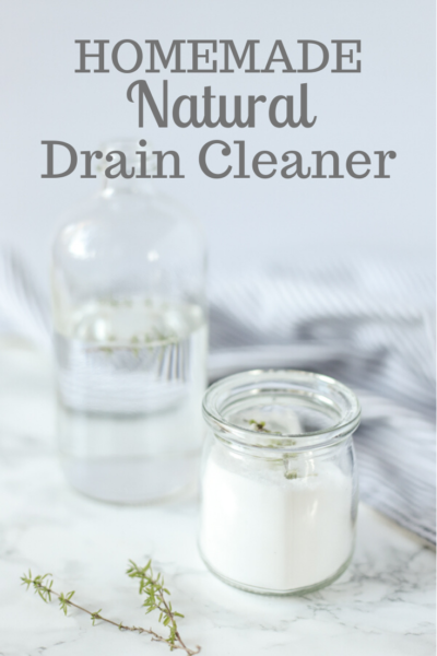 homemade drain cleaner ingredients on a marble countertop with a blue and white stripped towel in the background