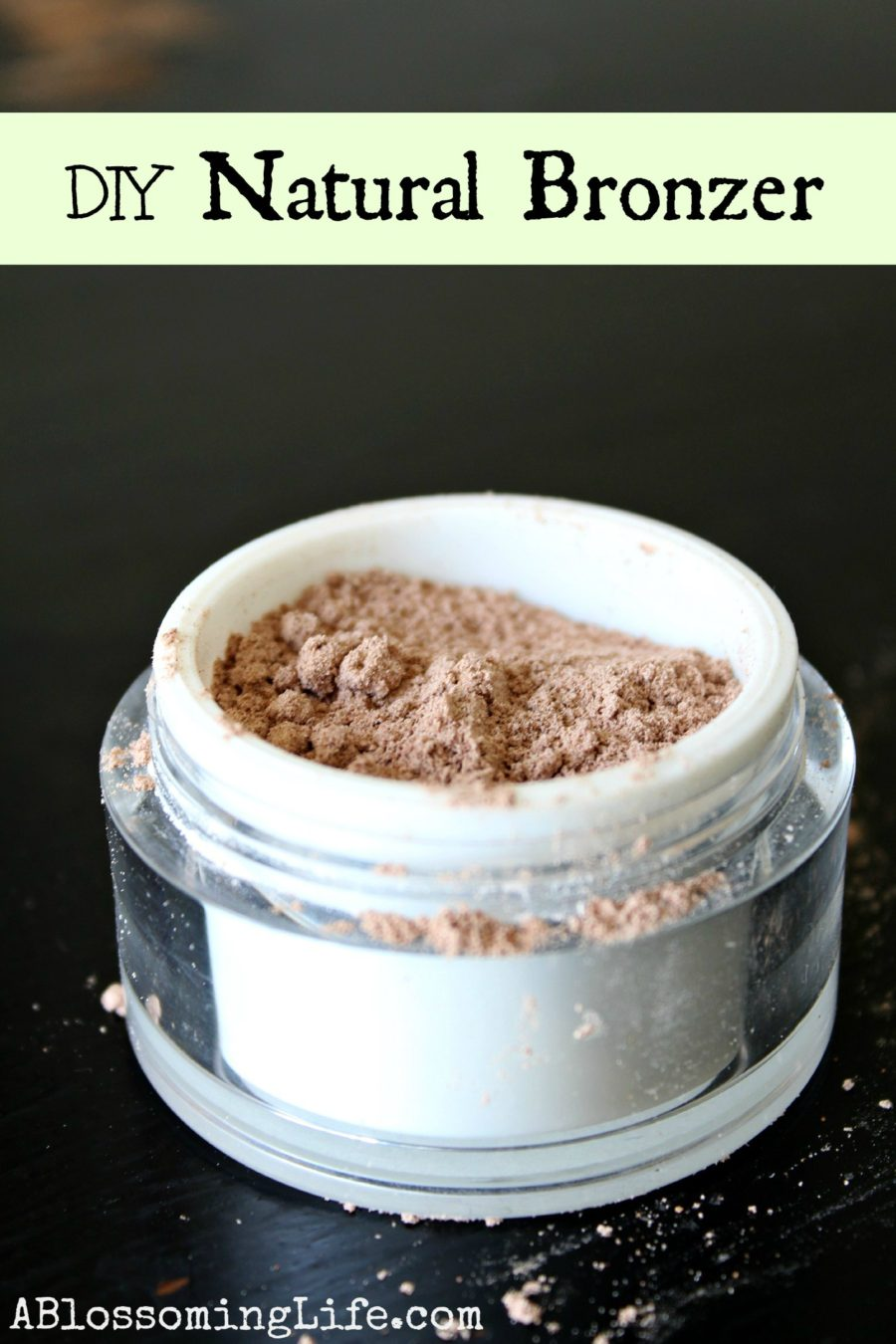 DIY Bronzer in a white and clear container on a black table