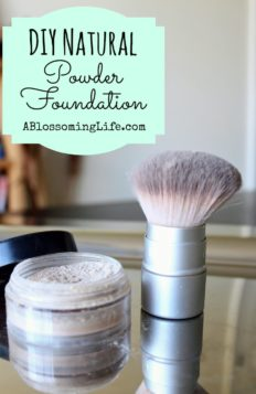 DIY foundation in a plastic container with a makeup brush next to it on a metal pan