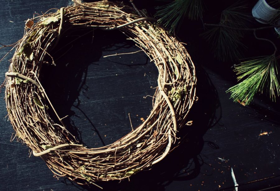Twig wreath on a black table getting ready to make a DIY Christmas Wreath