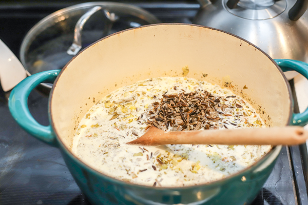 adding cream and cooked wild rice
