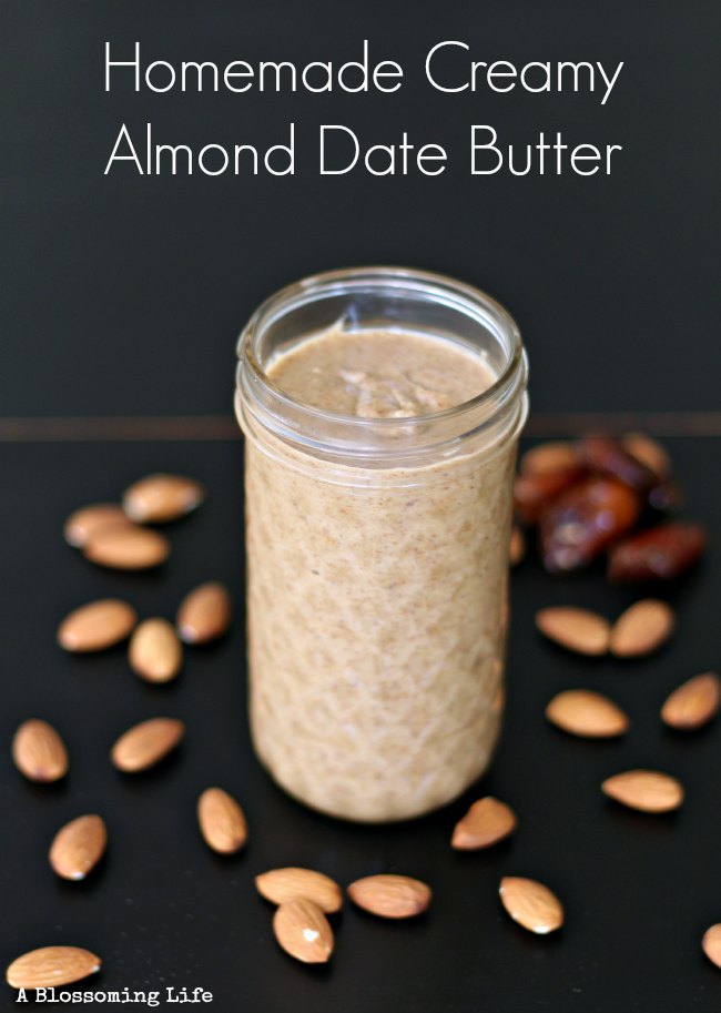 homemade almond butter in a mason jar with almond and dates spread around