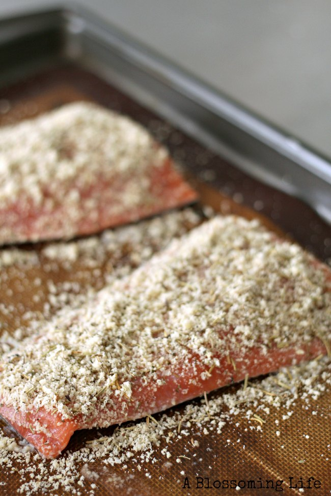 raw salmon with almond flour curst on a baking sheet
