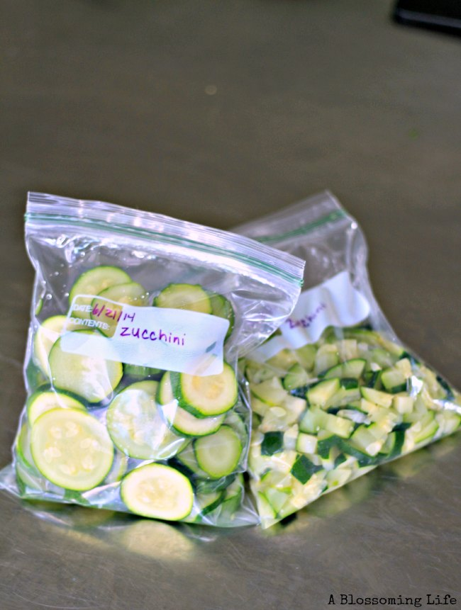 frozen zucchini in a plastic bags ready for the freezer