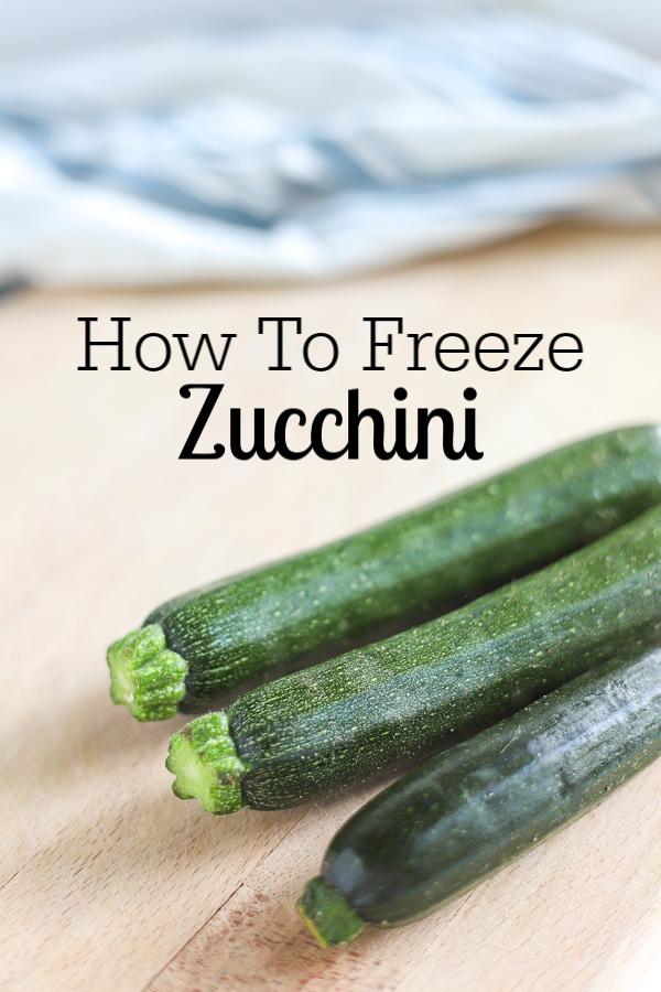 3 zucchini on a wood cutting board
