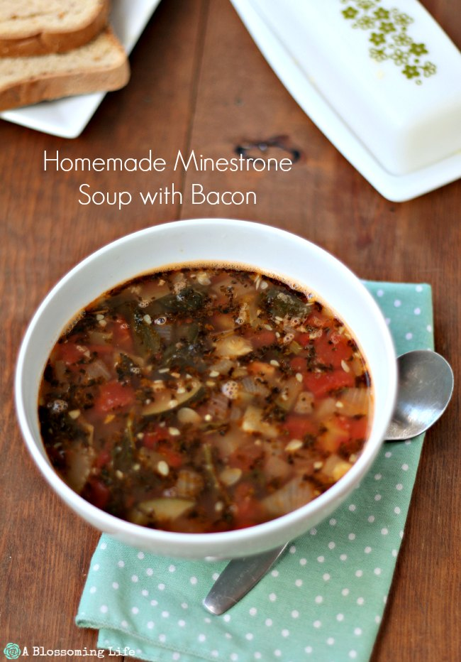 Homemade Minestrone Soup With Bacon in a white bowl on a teal and white polka dot napkin for whole30 recipes