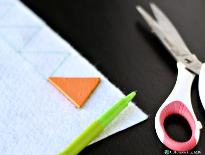 Cutting out triangles for DIY woodland themed mobile