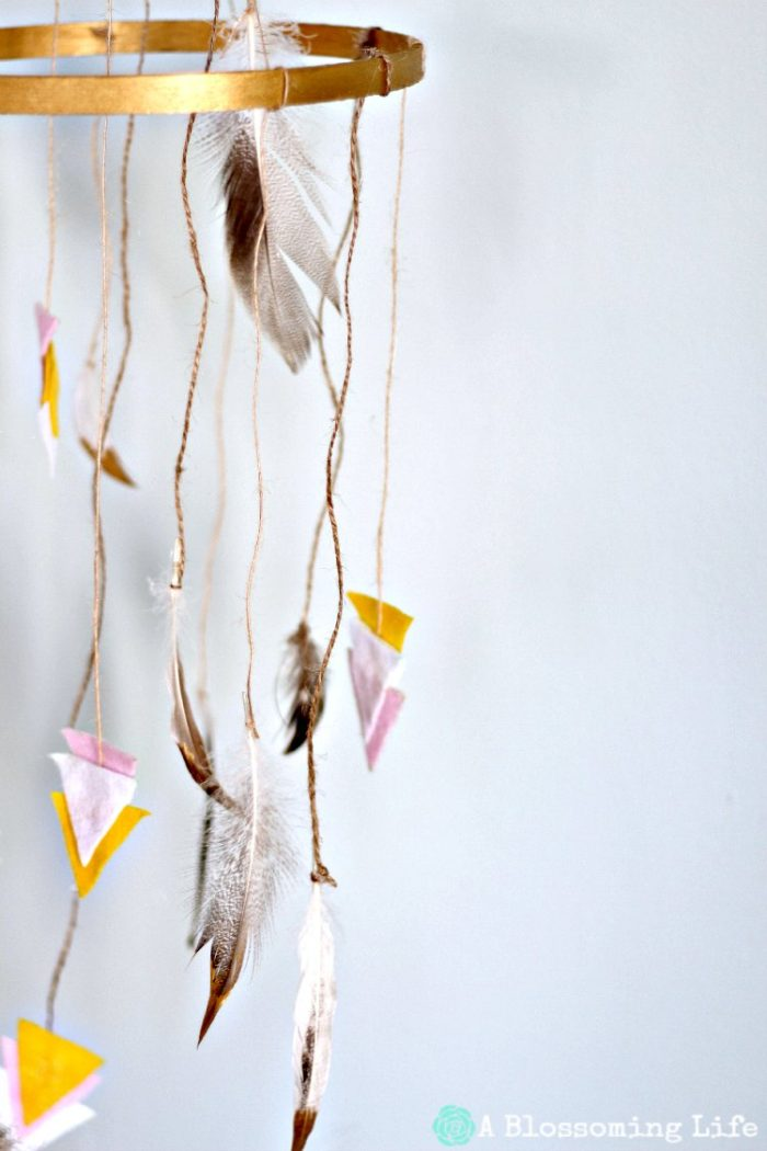 DIY Woodland Mobile with feathers and arrows