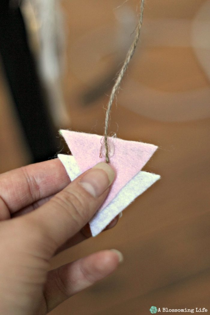 Glueing arrows together for DIY woodland themed mobile