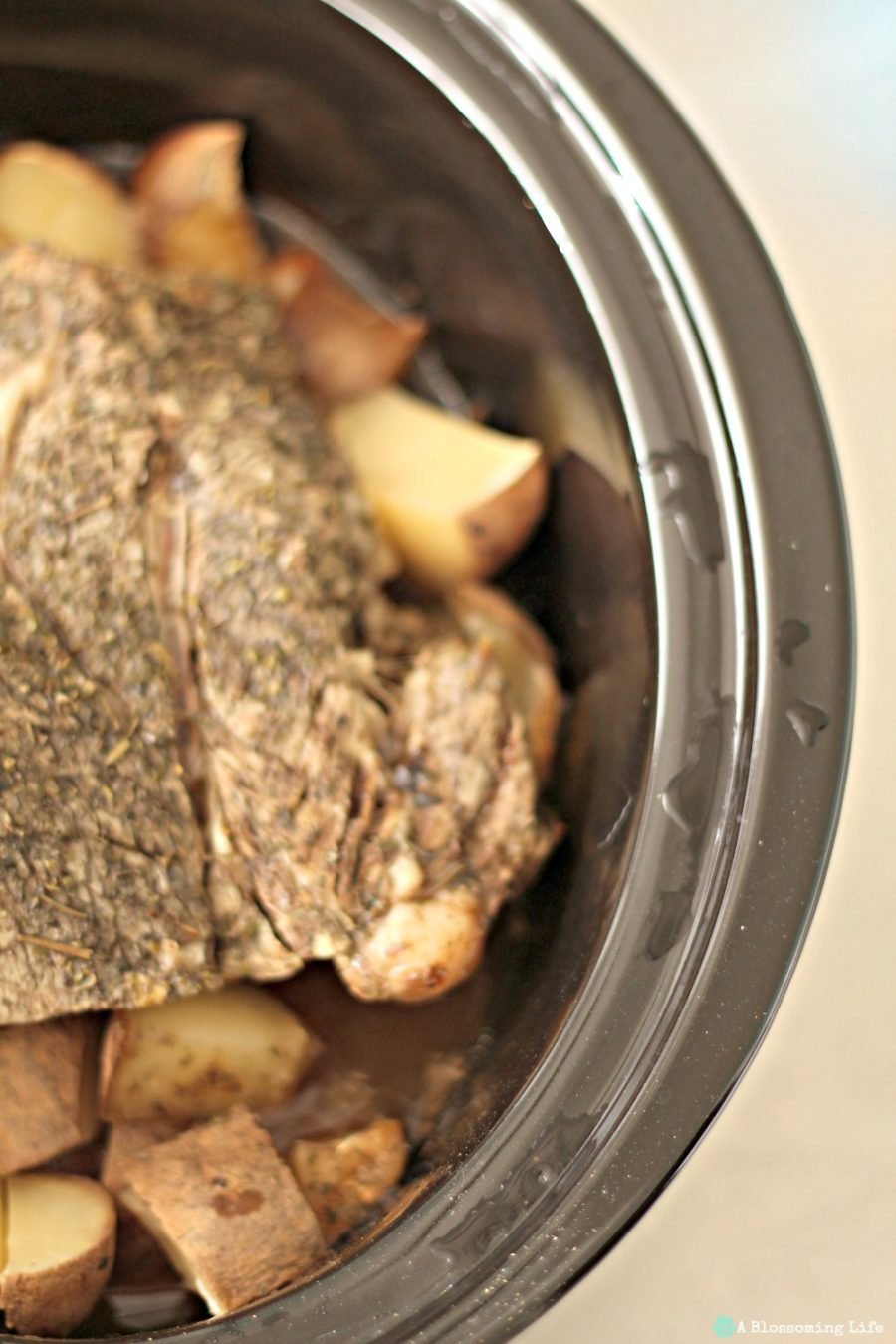 pot roast with carrots in potatoes in a slow cooker