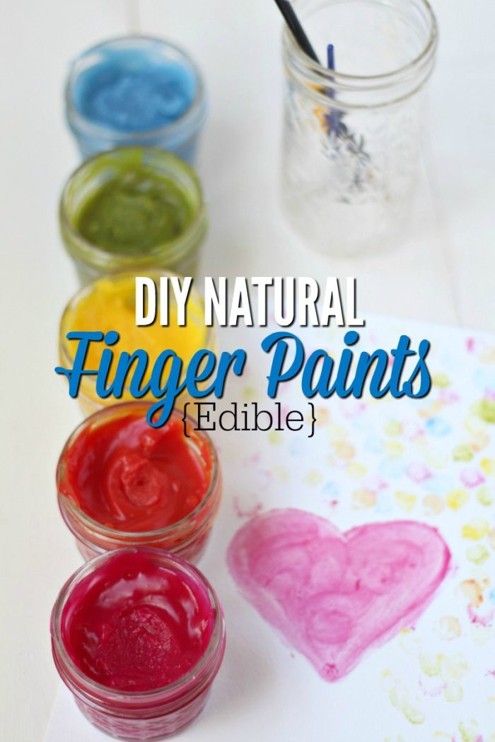 5 homemade finger paints in different colors in jars with a painting next to it