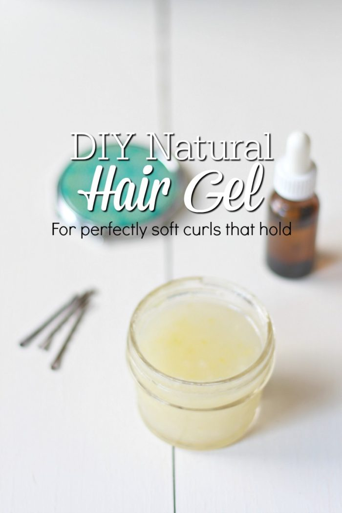 small jar of natural hair gel with bobby pins and a amber bottle in the background
