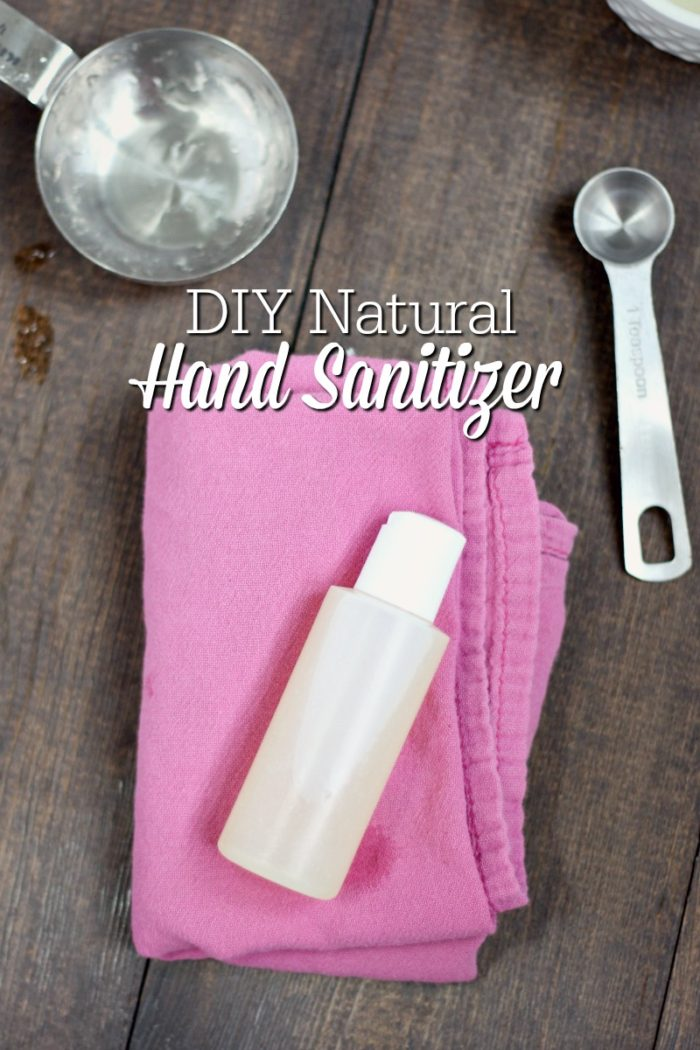 natural DIY hand sanitizer in a plastic container on top a pink napkin
