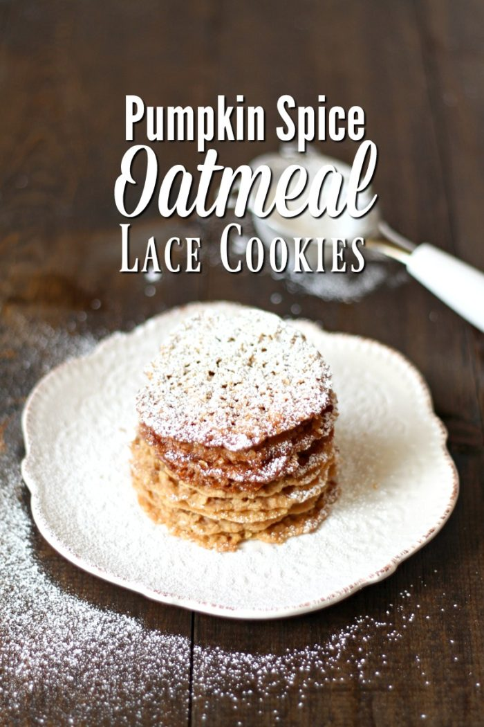 lace cookies on a cream plate topped with powdered sugar