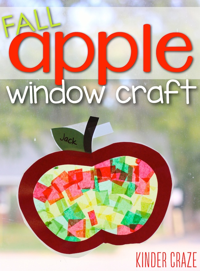 apple craft with tissue paper hanging on a window
