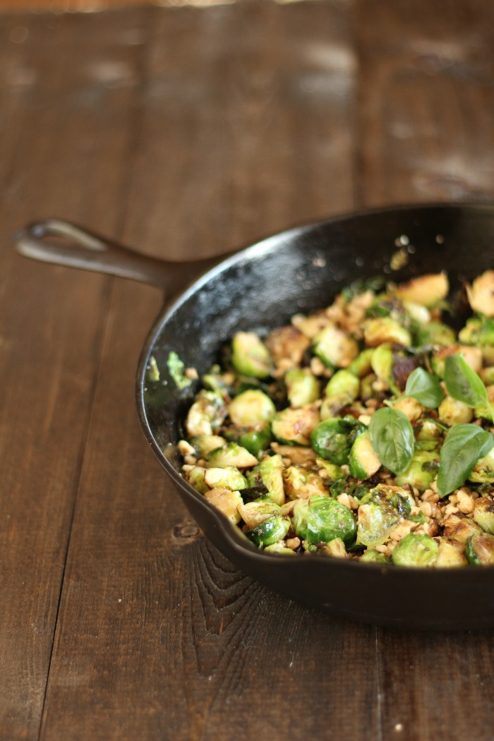 butter-basil-and-walnut-brussels-sprouts-in-a-cast-iron-skillet