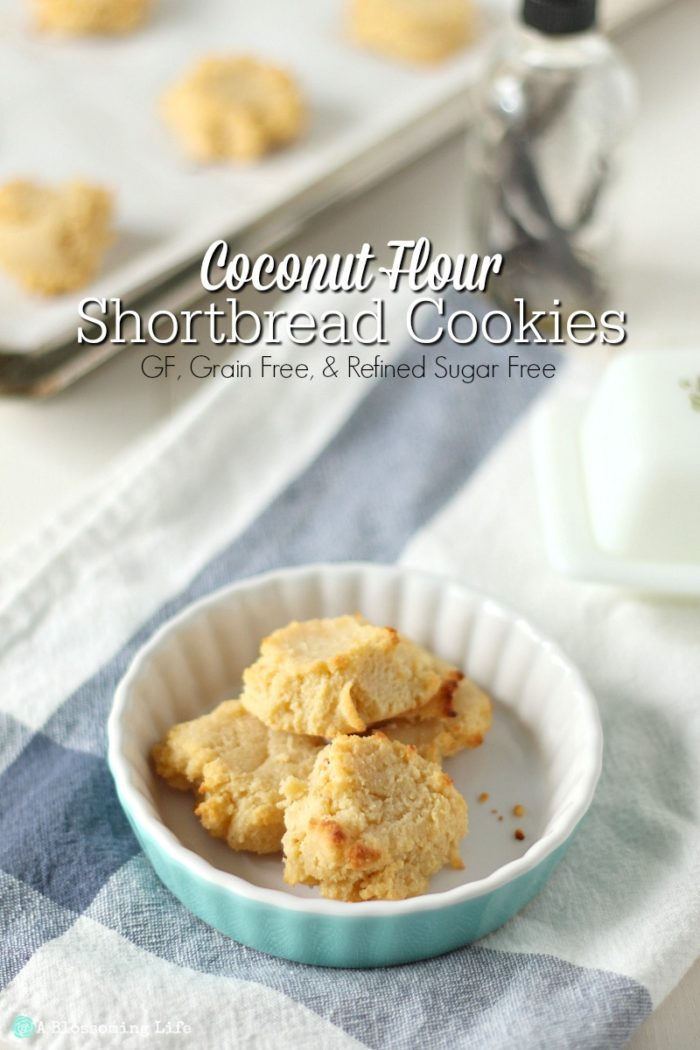 gluten free shortbread cookies in a teal tart dish on a blue and white towel