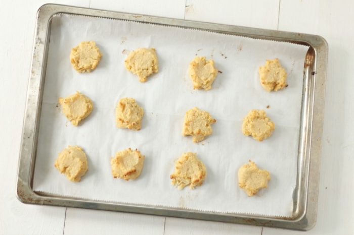 gluten free shortbread cookies on a parchment lined cookie sheet