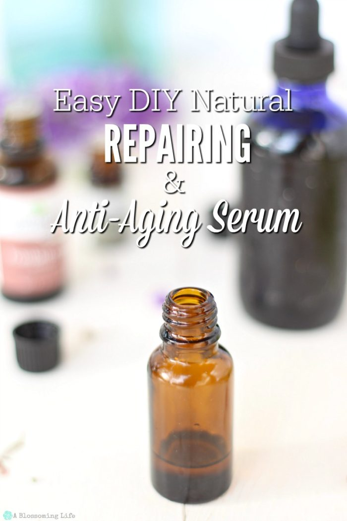 amber bottle of DIY face serum with a blue bottle and essential oils behind it