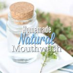 homemade mouthwash in a class jar on top a white plate with a flower