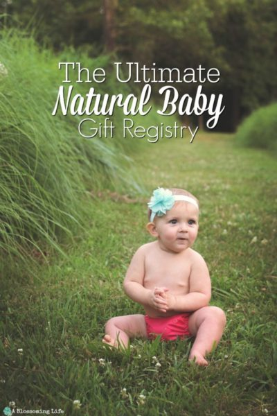 baby sitting in field with cloth diaper and a bow - minimalist baby registry