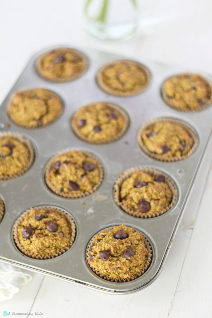 gluten free pumpkin muffins with chocolate chips in a muffin tin