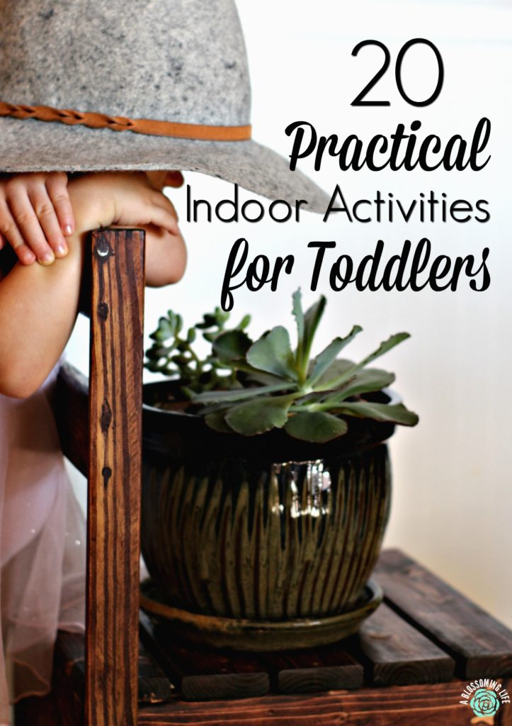 toddler wearing a had looking over a chair at a potted plant- indoor activities for toddlers