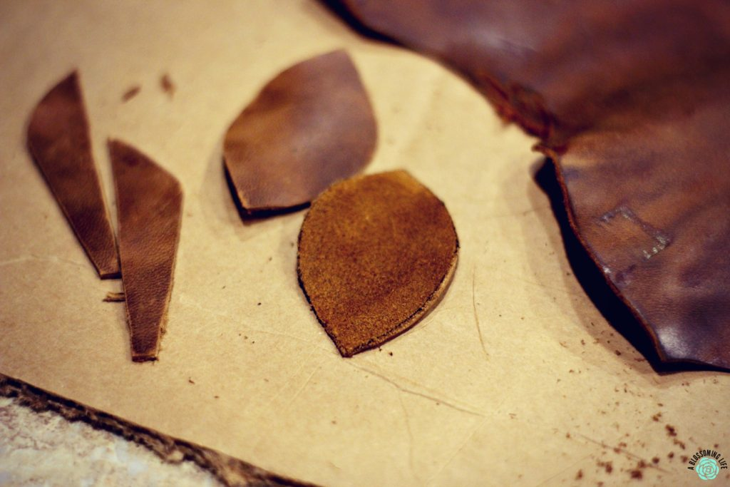 cutting out leather pieces for DIY leather earrings