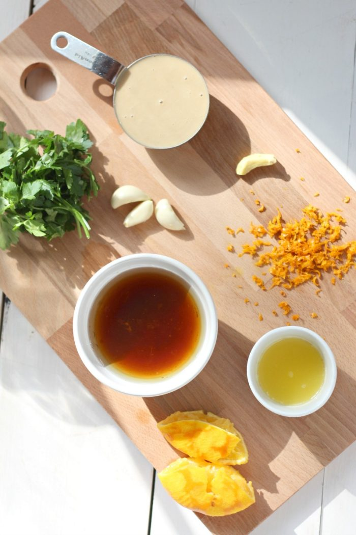ingredients to make goddess dressing on a wooden cutting board