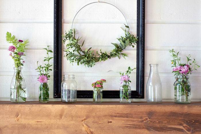 DIY Fireplace Mantel with stained wood on a white fireplace with shiplap