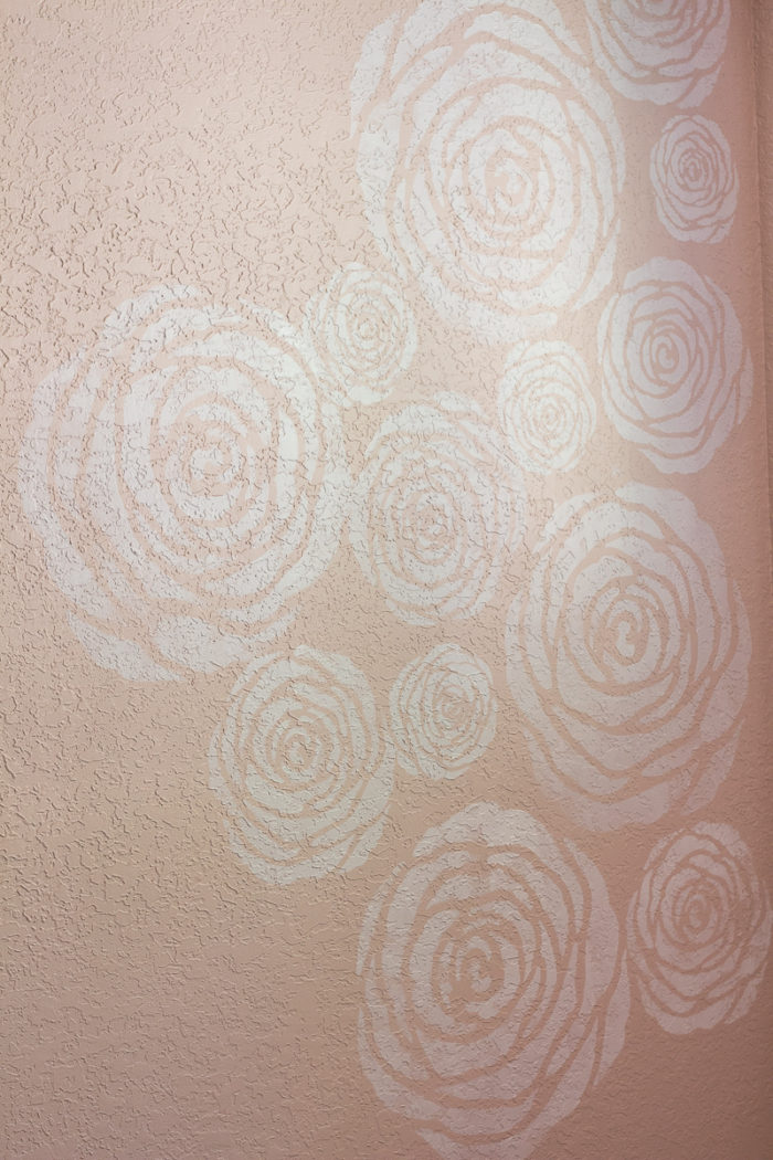 DIY stenciled flowers on a wall
