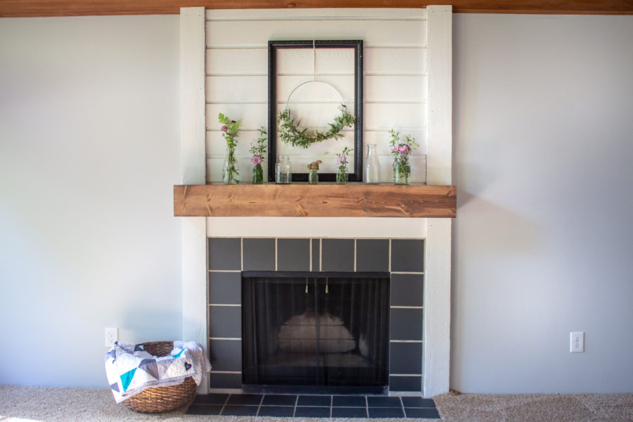 Transform your fireplace on a tight budget with this easy step-by-step tutorial on how to paint your fireplace surround and tile. Plus, learn how to easily paint stained wood with low VOC products.