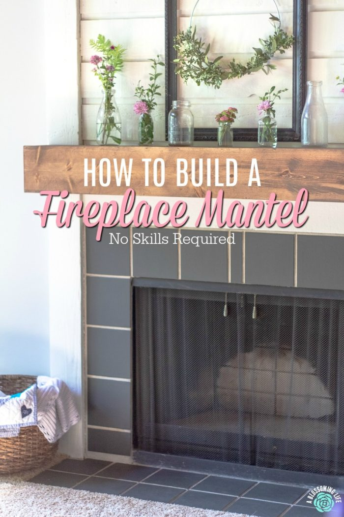 stained DIY fireplace mantel with glass bottles on top - learn how to build a fireplace mantel