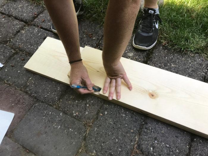 measuring wood for DIY fireplace mantel