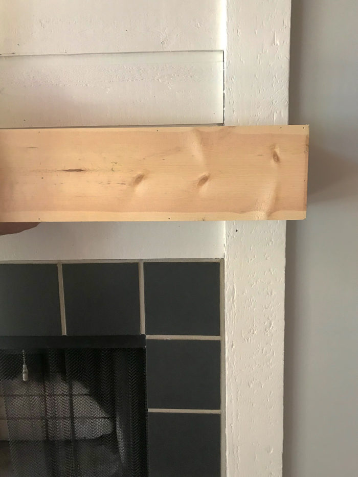 dry fitting DIY Fireplace mantel into place