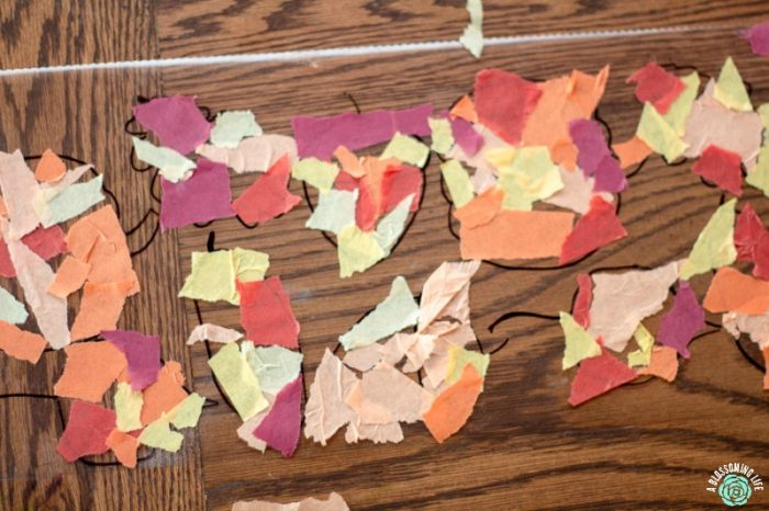 crating fall sun catchers with contact paper and tissue paper