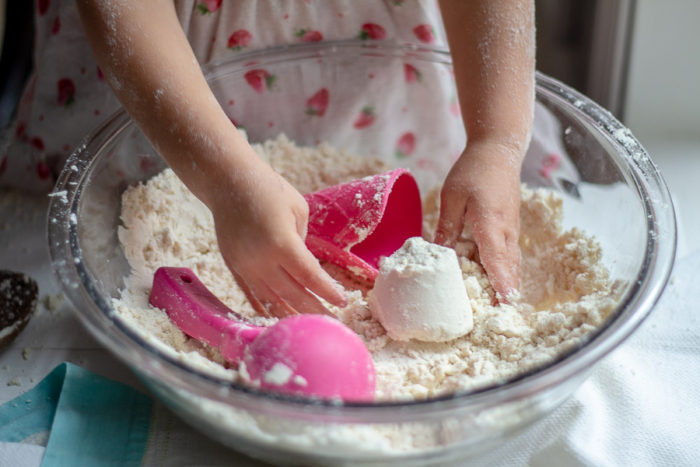 child sculpting with cloud dough