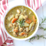 Bowl of chicken lentil soup that is full of carrots, potatoes, and beans in a nourishing chicken broth.
