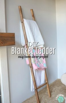 DIy blanket ladder with blankets resting on it against the wall