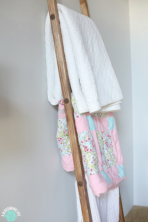 close up of a diy blanket ladder with blankets resting up against a wall