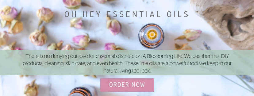 essential oils with dried flowers around it
