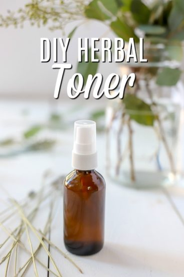 diy toner in a amber bottle with lavender and eucalyptus around it