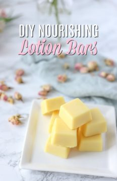 DIY lotion bars on a white place with dried roses and a blue napkin behind it