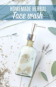 homemade face wash in a glass soap pump with dried lavender around the DIY face wash