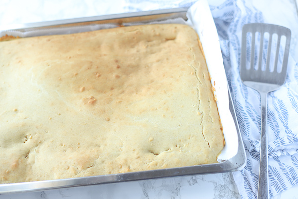 sheet pan pancakes in a parchment lined cookie sheet