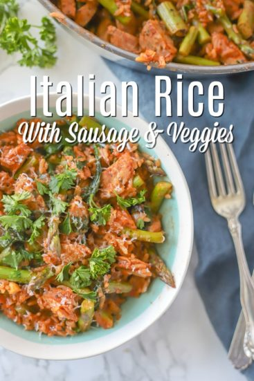 Italian rice dish with sausage in a cream and teal bowl