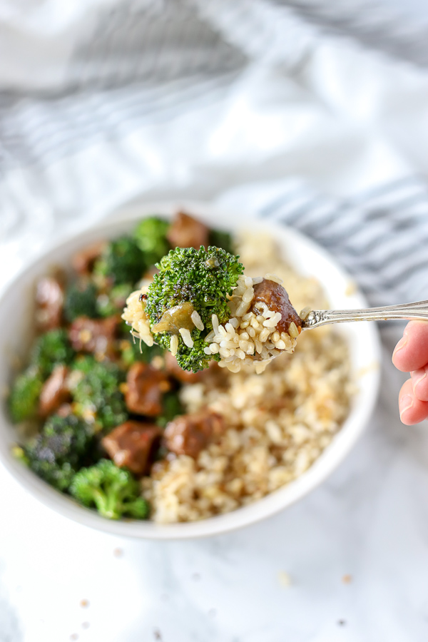 fork holding beef and broccoli