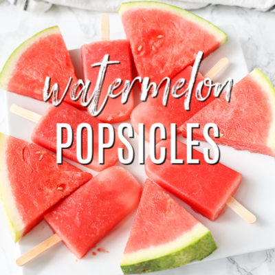 watermelon popsicles on a white plate with watermelon