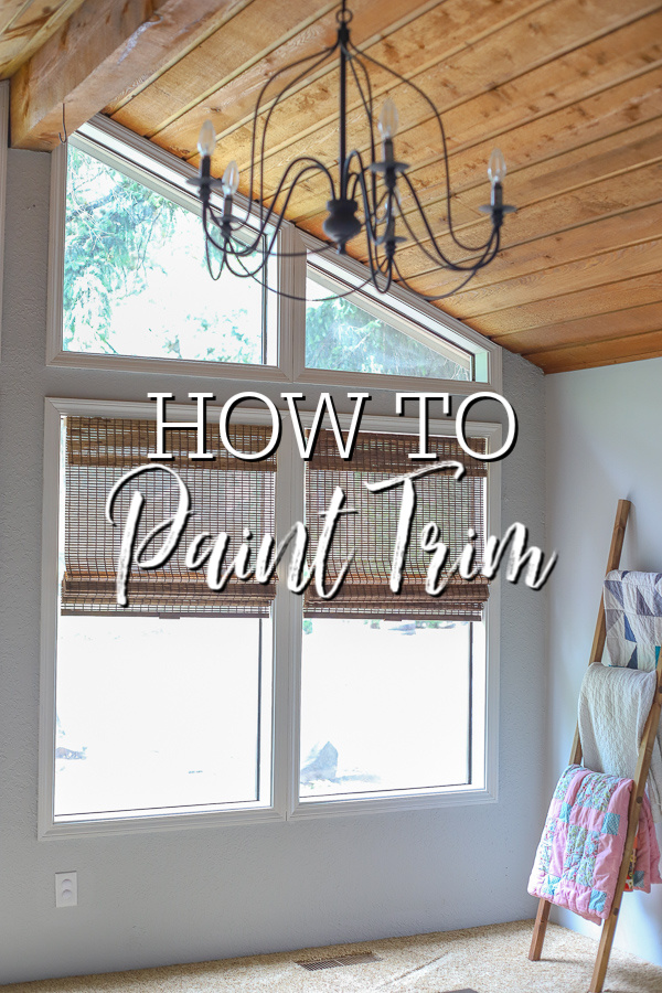 room with vaulten ceilings with freshly painted white time - how to paint trim